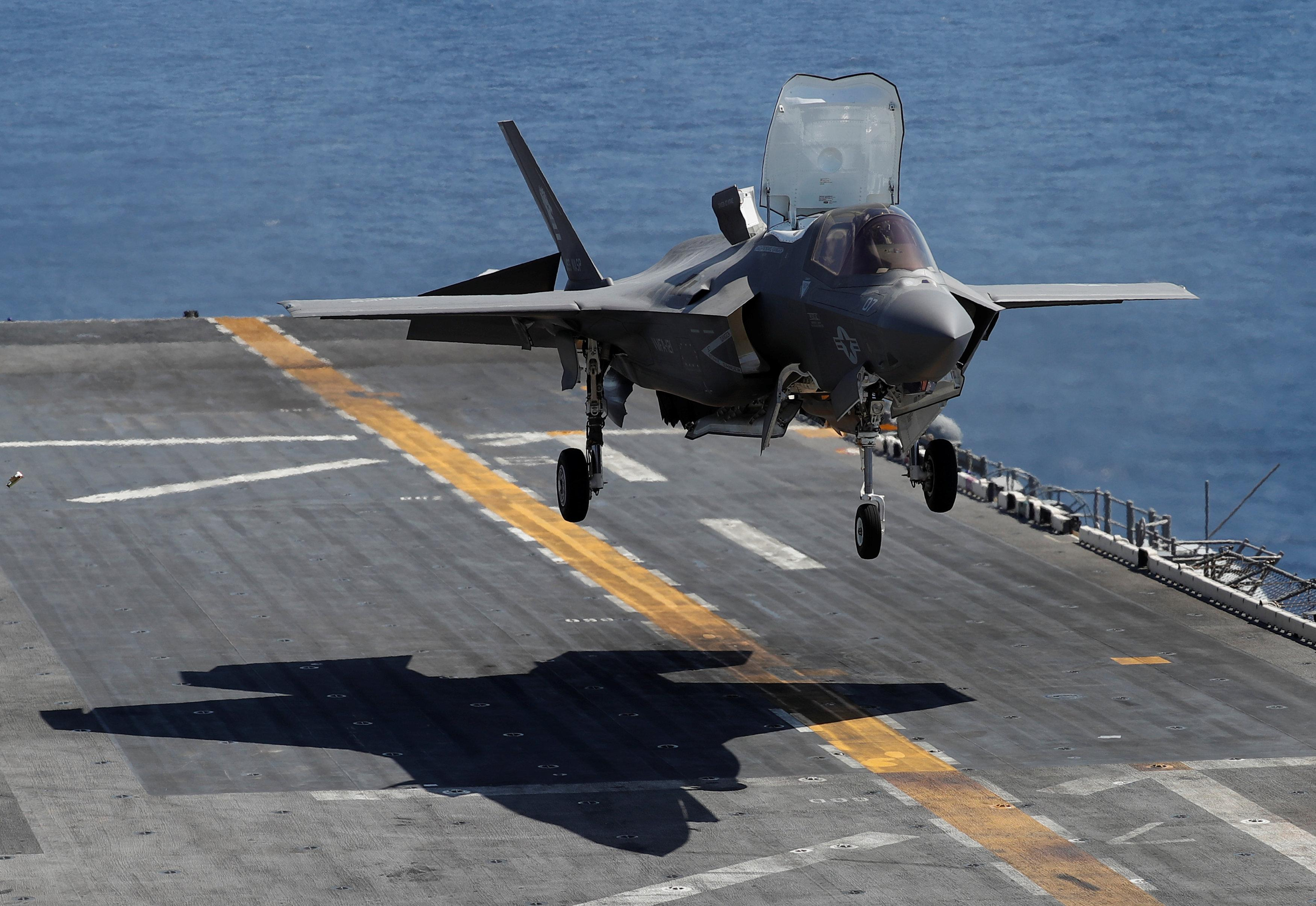 A Marine Corps pilot prepares for a vertical landing of Lockheed Martin F-35B stealth fighter aboard the USS Wasp amphibious assault carrier during their operation in the waters off Japan