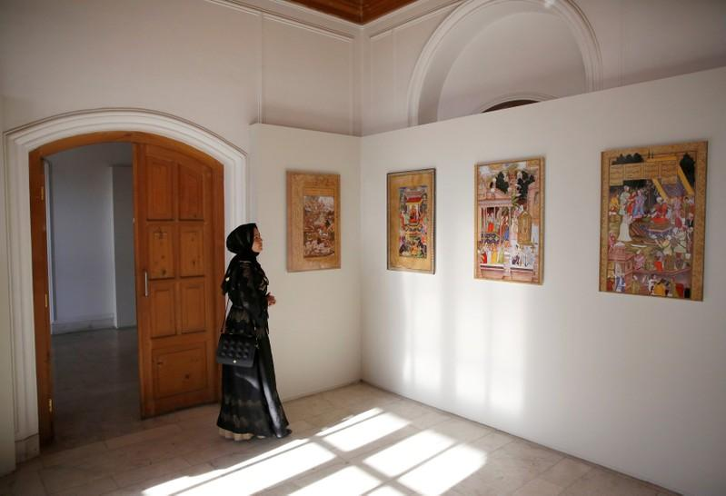 An Afghan woman looks at art exhibition at Babur Garden in Kabul, Afghanistan March 31, 2018. Picture taken March 31, 2018. Mohammad Ismail