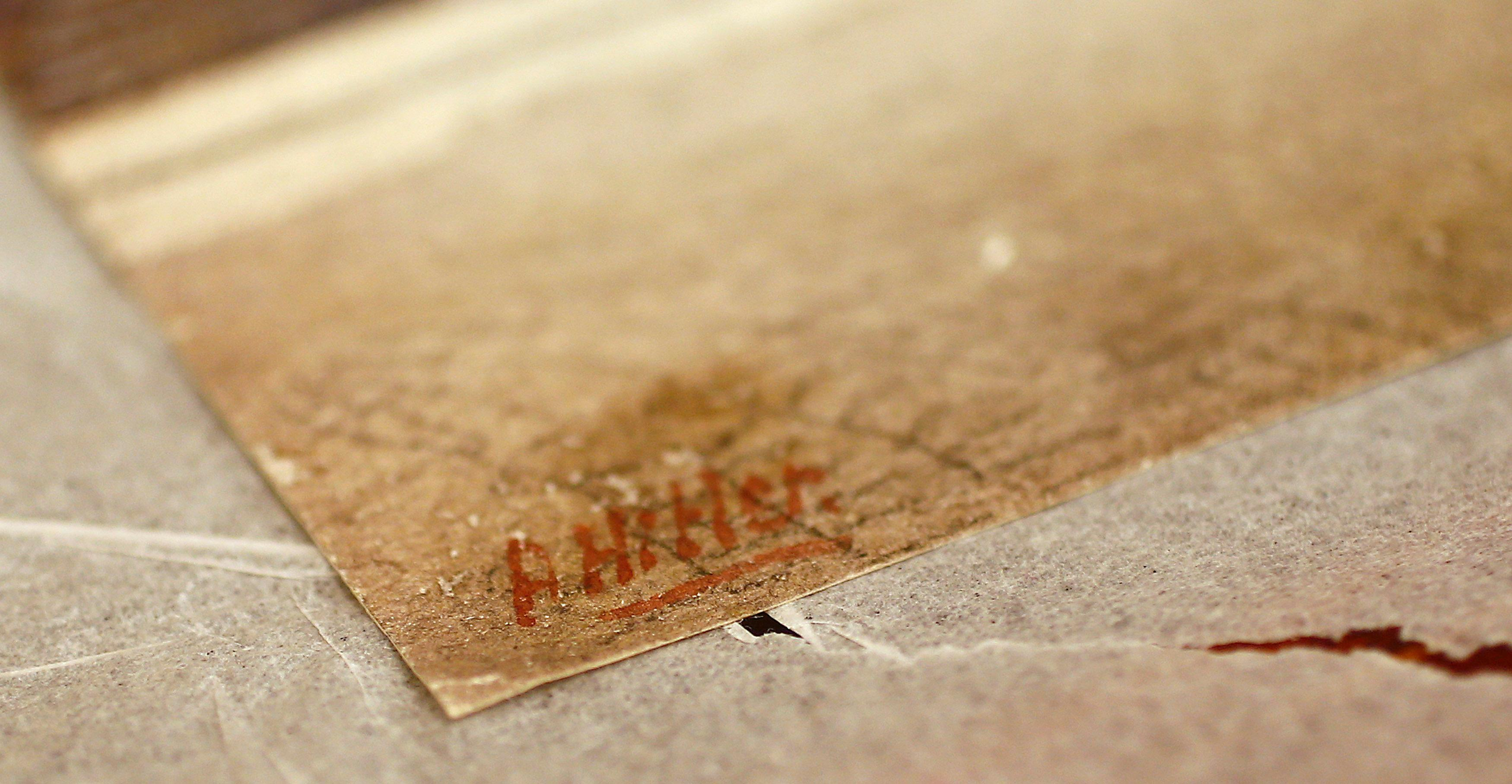 The signature of former German dictator Adolf Hitler is seen on a painting of the old registry office in Munich, at Weidler auction house in Nuremberg November 18, 2014.    Kai Pfaffenbach