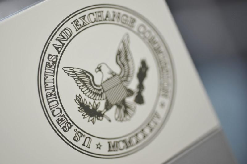 The U.S. Securities and Exchange Commission logo adorns an office door at the SEC headquarters in Washington, June 24, 2011.  Jonathan Ernst