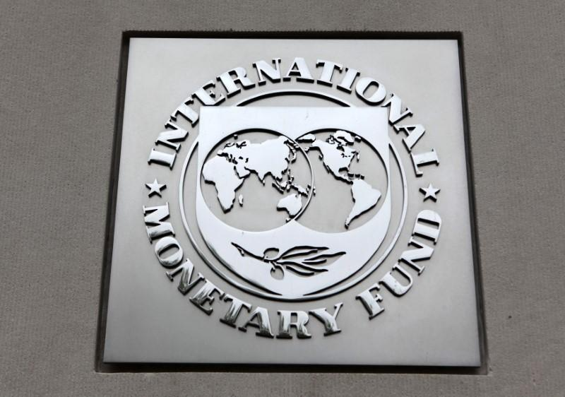 The International Monetary Fund (IMF) logo is seen at the IMF headquarters building in Washington, April 18, 2013. Yuri Gripas