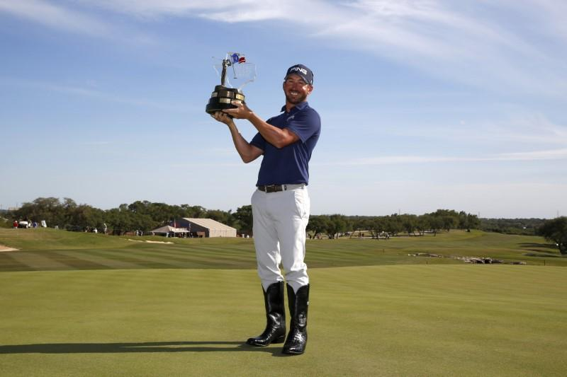 Apr 22, 2018; San Antonio, TX, USA; Andrew Landry celebrates with the trophy after the final round of the Valero Texas Open golf tournament at TPC San Antonio - AT&T Oaks Course. Mandatory Credit: Soobum Im-USA TODAY Sports