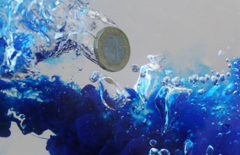 UK pound coin plunges into water in this illustration picture, October 26, 2017.   Dado Ruvic