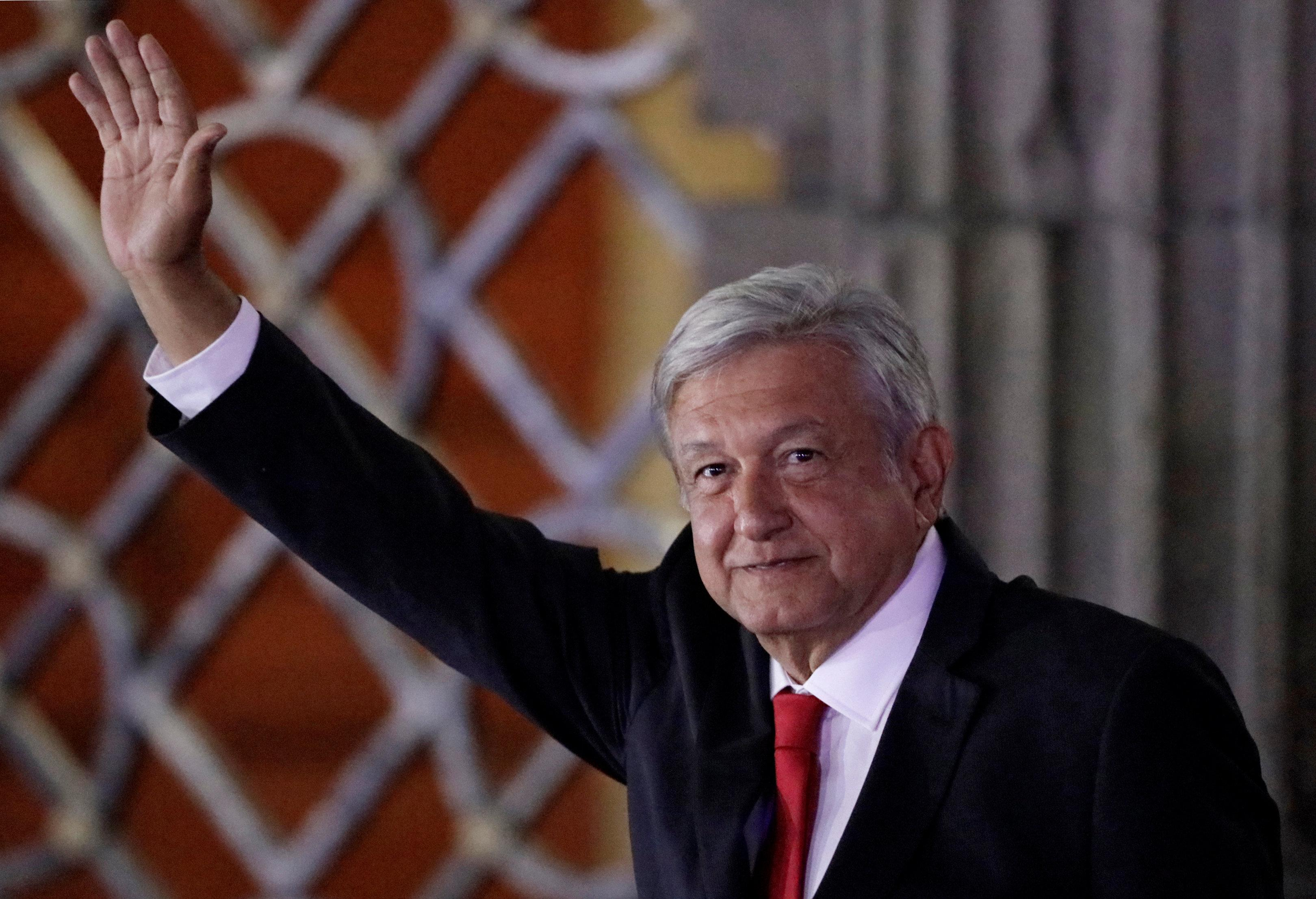 Leftist front-runner Andres Manuel Lopez Obrador of the National Regeneration Movement (MORENA) gestures while leaving the Palacio de Mineria after the first presidential debate in Mexico City, Mexico April 22, 2018. Henry Romero