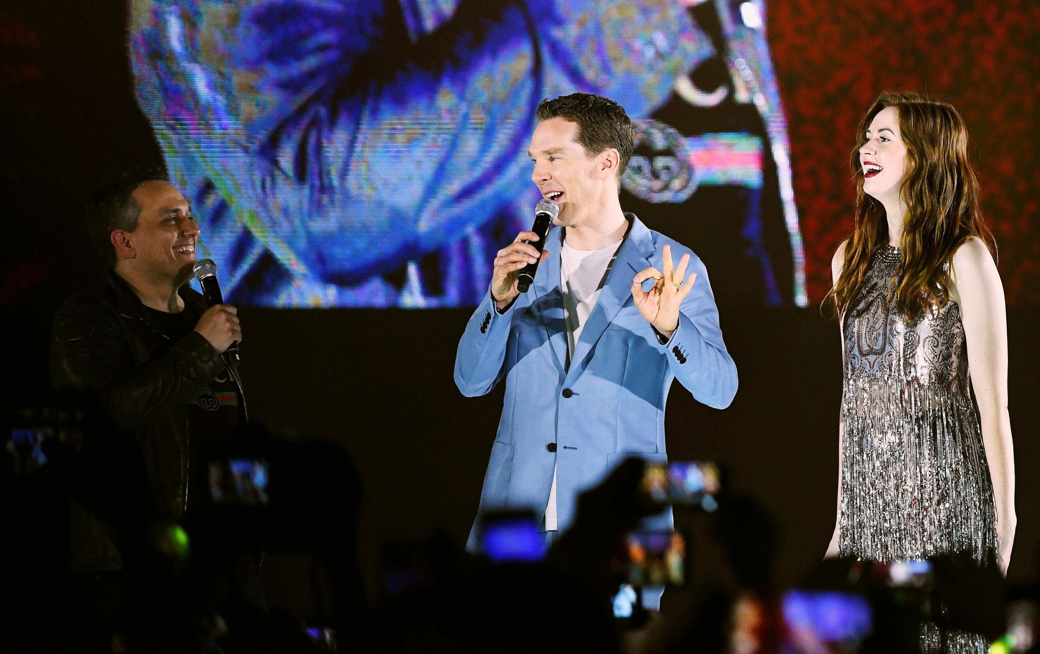 Cast member Benedict Cumberbatch talks with director Joe Russo as cast member Karen Gillan reacts at a fan event for Marvel Studio's Avengers: Infinity War movie, in Singapore April 16, 2018. Feline Lim