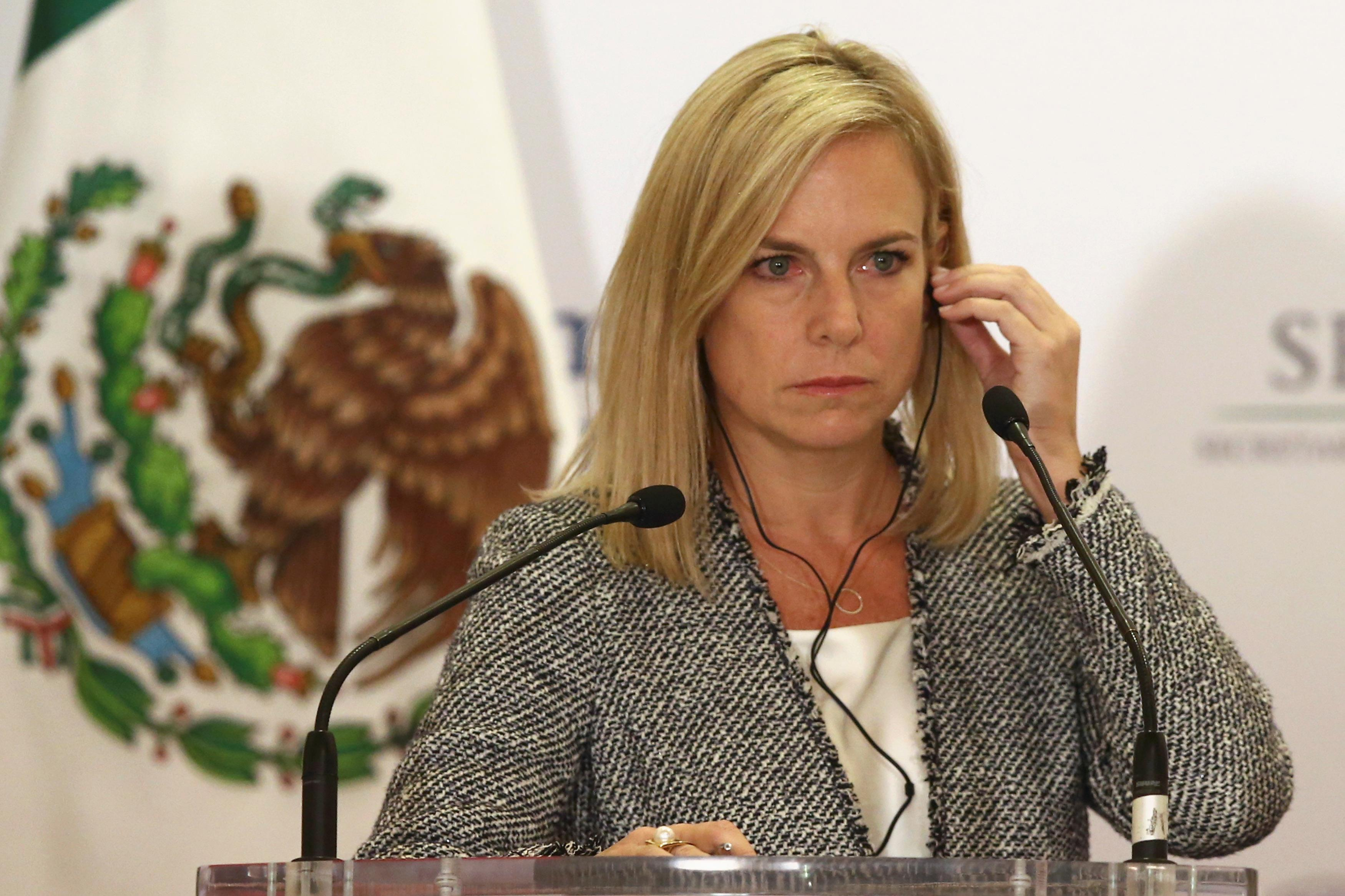 U.S. Homeland Security Secretary Kirstjen Nielsen adjusts her headset as she delivers a joint message with Mexico's Interior Minister Alfonso Navarrete Prida (not pictured) in Mexico City, Mexico March 26, 2018. Edgard Garrido