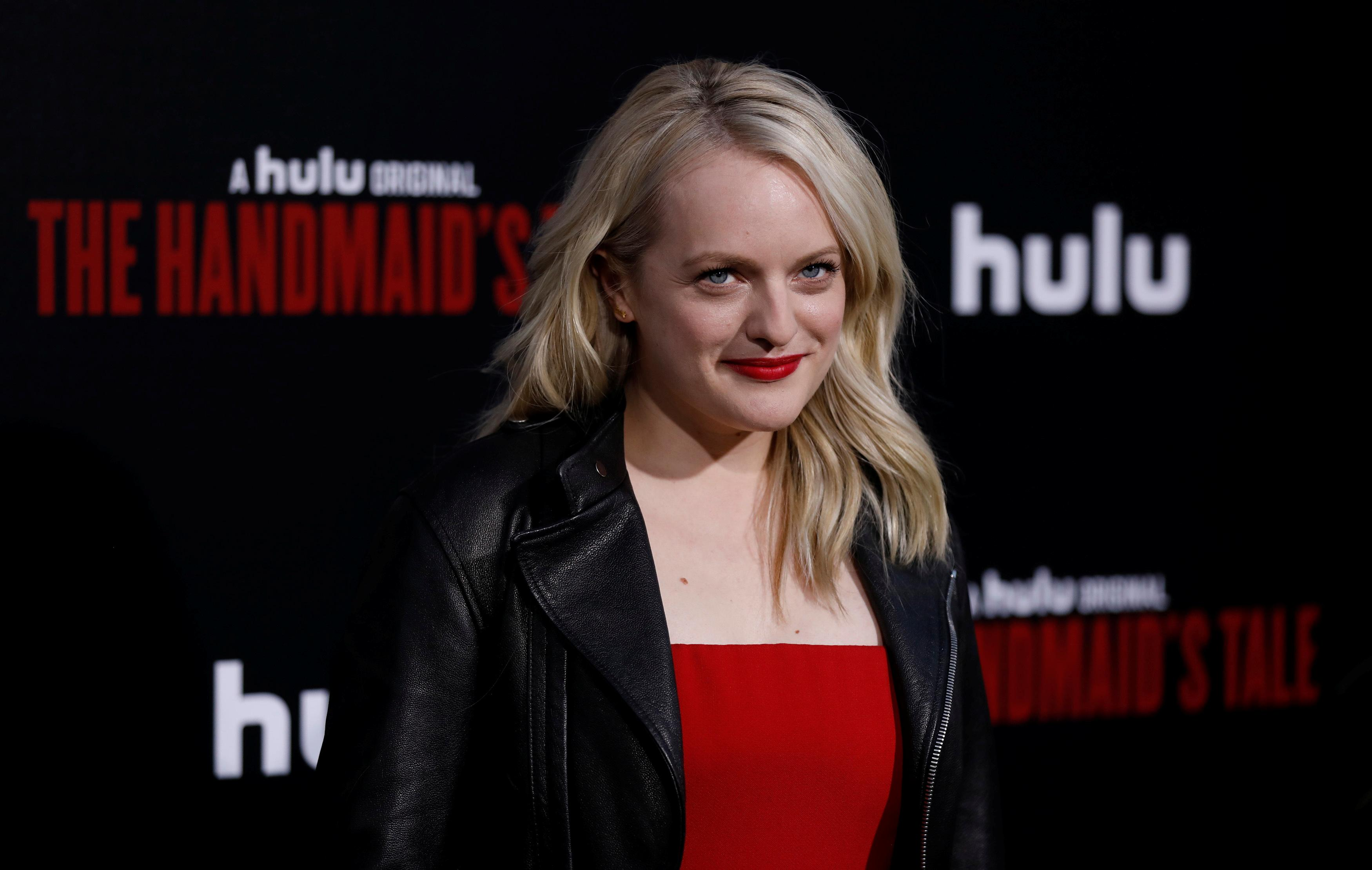 Cast member Elisabeth Moss poses at the premiere for the second season of the television series