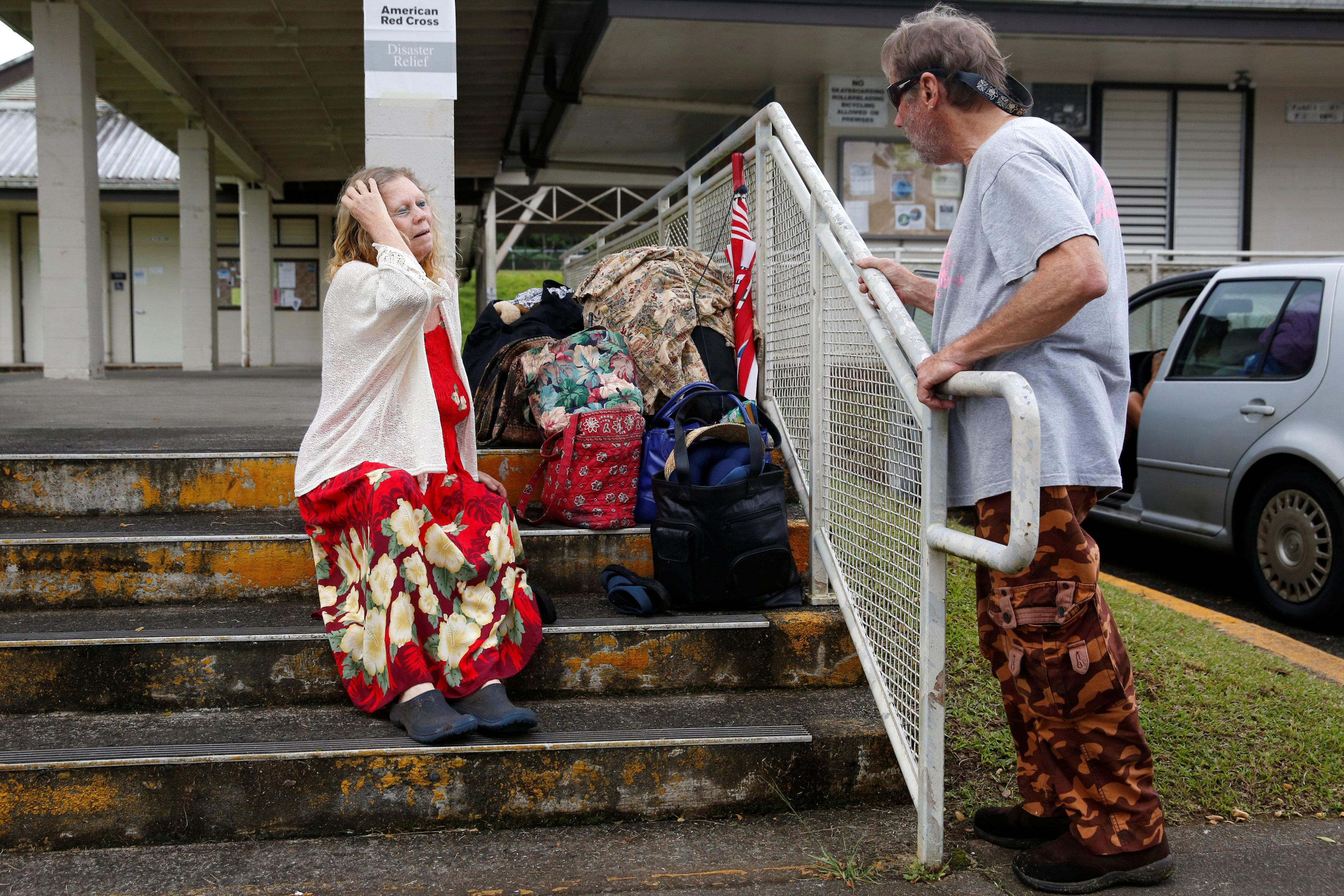 Carolyn McNamara, 70, talks with her neighbour, Paul Campbell, 68, at an evacuation center in Pahoa after moving out of their homes in Leilani Estates after the Kilauea Volcano erupted on Thursday after a series of earthquakes over the last couple of days, in Hawaii, U.S., May 4, 2018.  Terray Sylvester