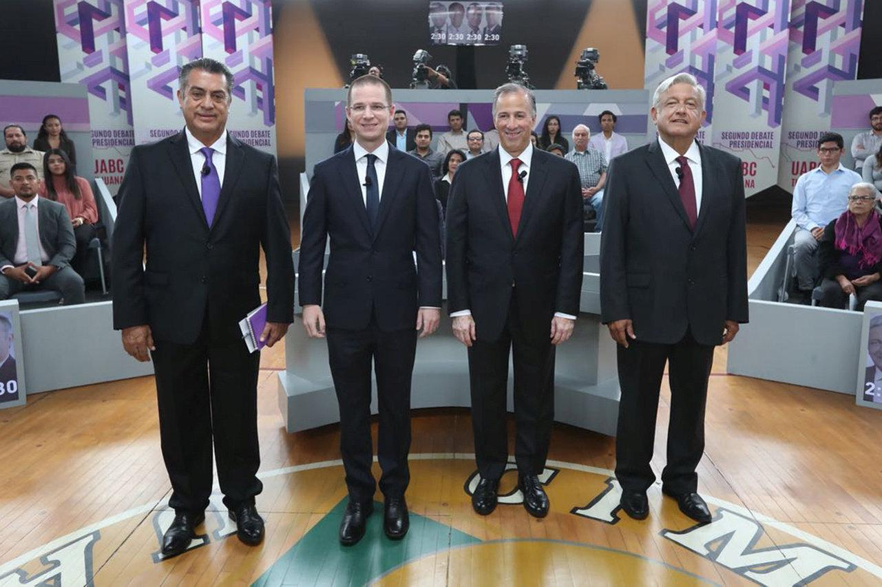 (L-R) Independent candidate Jaime Rodriguez Calderon, Ricardo Anaya of the National Action Party (PAN), Jose Antonio Meade of the Institutional Revolutionary Party (PRI) and Andres Manuel Lopez Obrador of the National Regeneration Movement (MORENA)  pose for a photo in their second televised debate in Tijuana, Mexico in this May 20, 2018 handout released to Reuters by the National Electoral Institute (INE). National Electoral Institute/Handout via