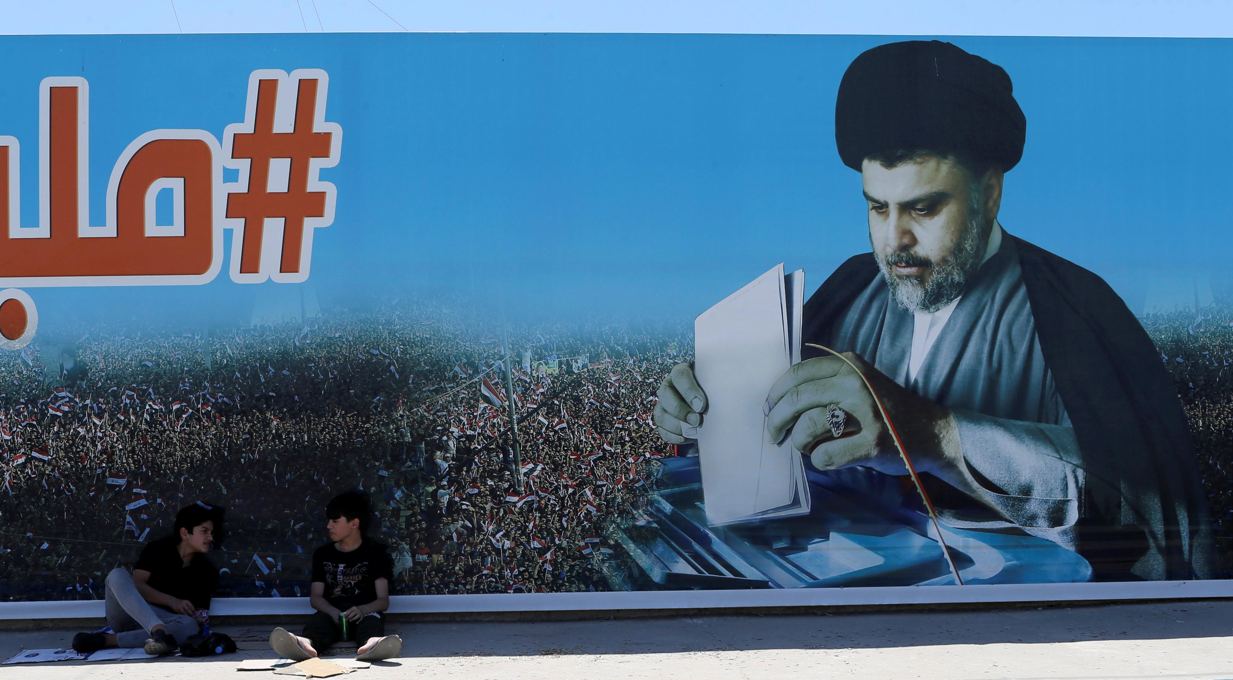 A poster of Iraqi Shi'ite cleric Moqtada al-Sadr in the Sadr City district of Baghdad, Iraq May 19, 2018. Thaier al-Sudani