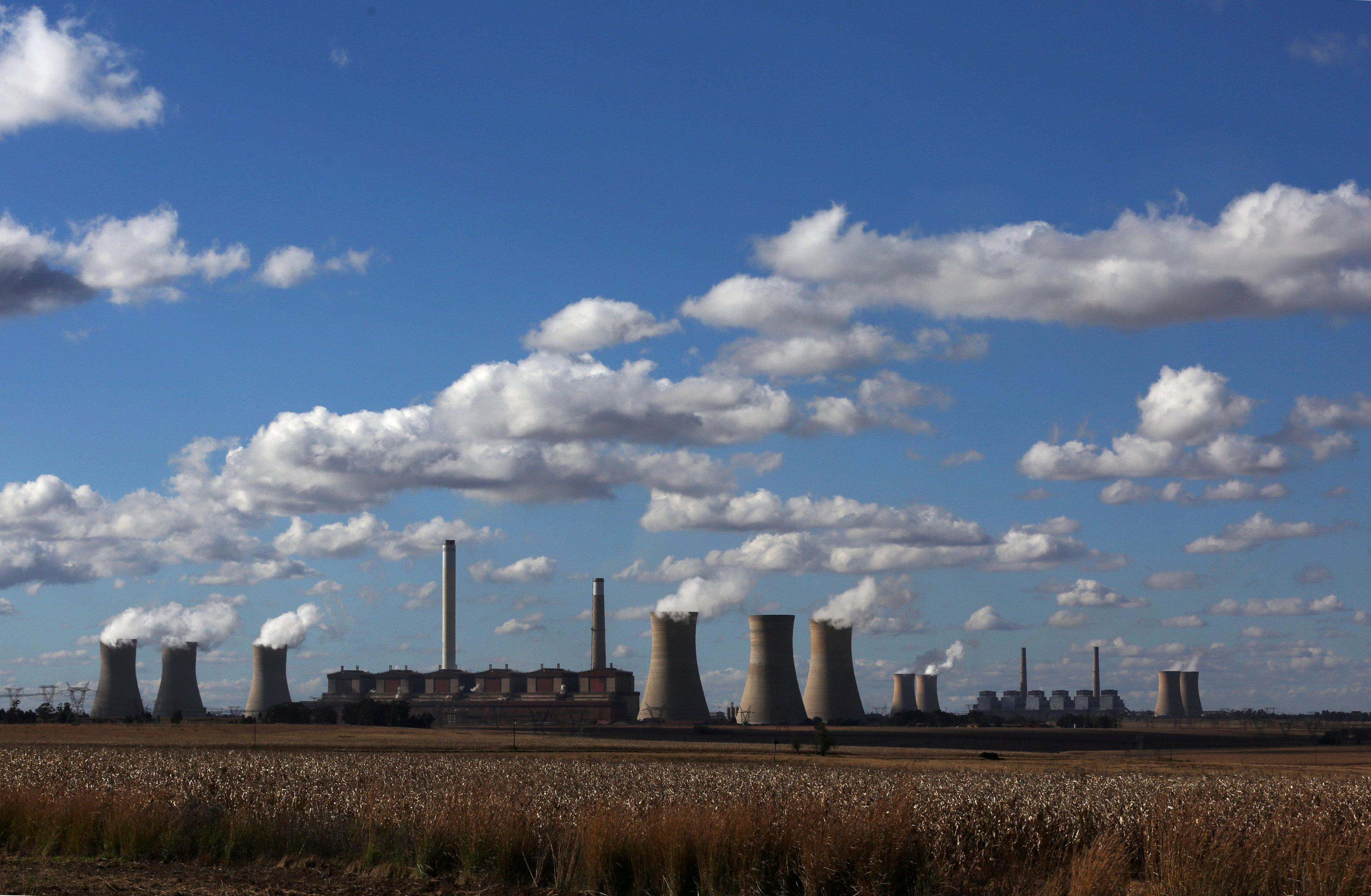 Smoke rises from the cooling towers of Matla Power Station, a coal-fired power plant operated by Eskom in Mpumalanga province, South Africa, May 20, 2018. Siphiwe Sibeko