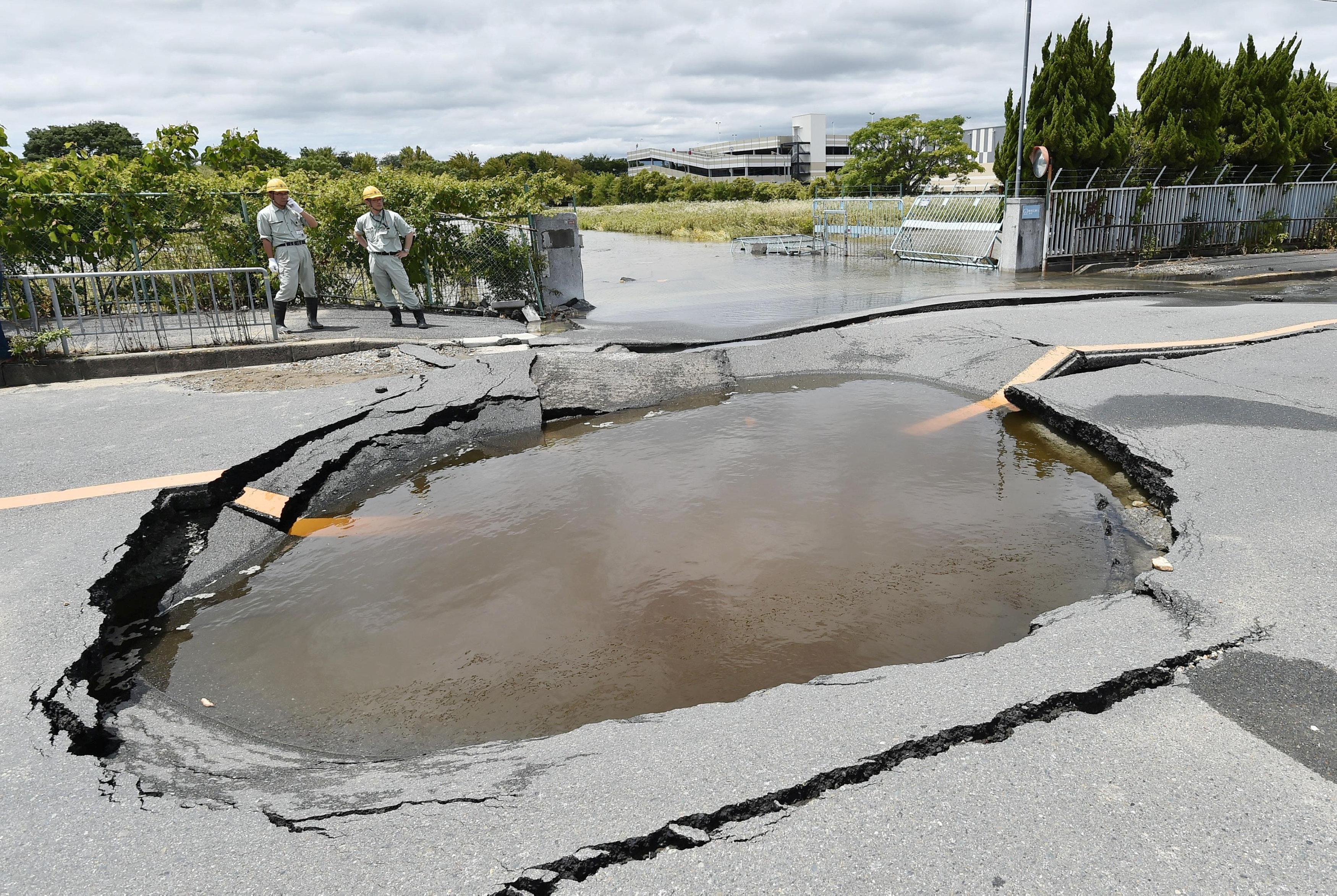 A water-filled crack on a road after water pipes were broken due to an earthquake is seen in Takatsuki, Osaka prefecture, western Japan, in this photo taken by Kyodo June 18, 2018.   Mandatory credit Kyodo/via  ATTENTION EDITORS - THIS IMAGE WAS PROVIDED BY A THIRD PARTY. MANDATORY CREDIT. JAPAN OUT. NO COMMERCIAL OR EDITORIAL SALES IN JAPAN.