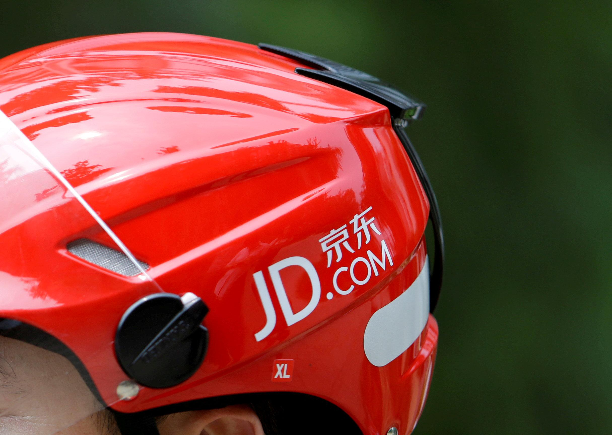 A logo of JD.com is seen on a helmet of a delivery man in Beijing, China June 16, 2014. Picture taken June 16, 2014. Jason Lee