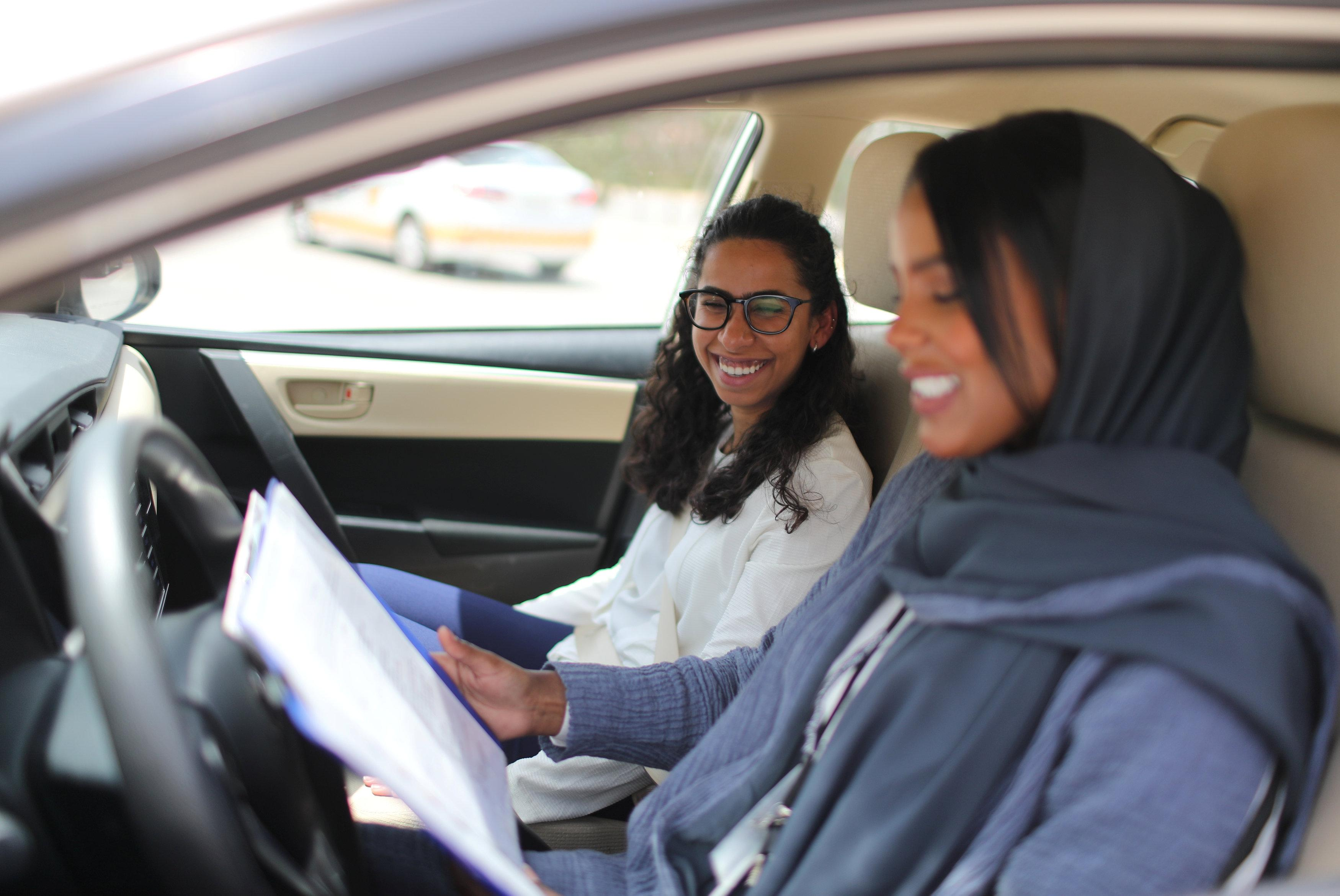 Driving instructor Ahlam al-Somali (R) reads instructions before getting ready to drive with trainee Maria al-Faraj at Saudi Aramco Driving Center in Dhahran, Saudi Arabia, June 6, 2018. Ahmed Jadallah