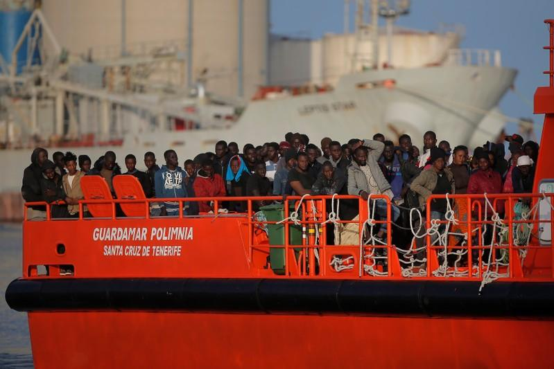 Migrants, part of a group intercepted aboard three dinghies off the coast in the Mediterranean Sea, stand on a rescue boat upon arrival at the port of Malaga, Spain June 18, 2018. Jon Nazca