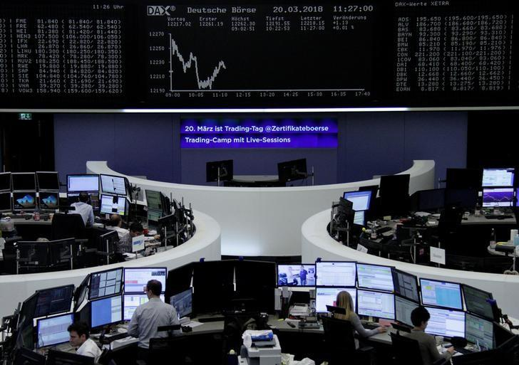 The German share price index, DAX board, is seen at the stock exchange in Frankfurt, Germany, March 20, 2018.    Staff/Remote