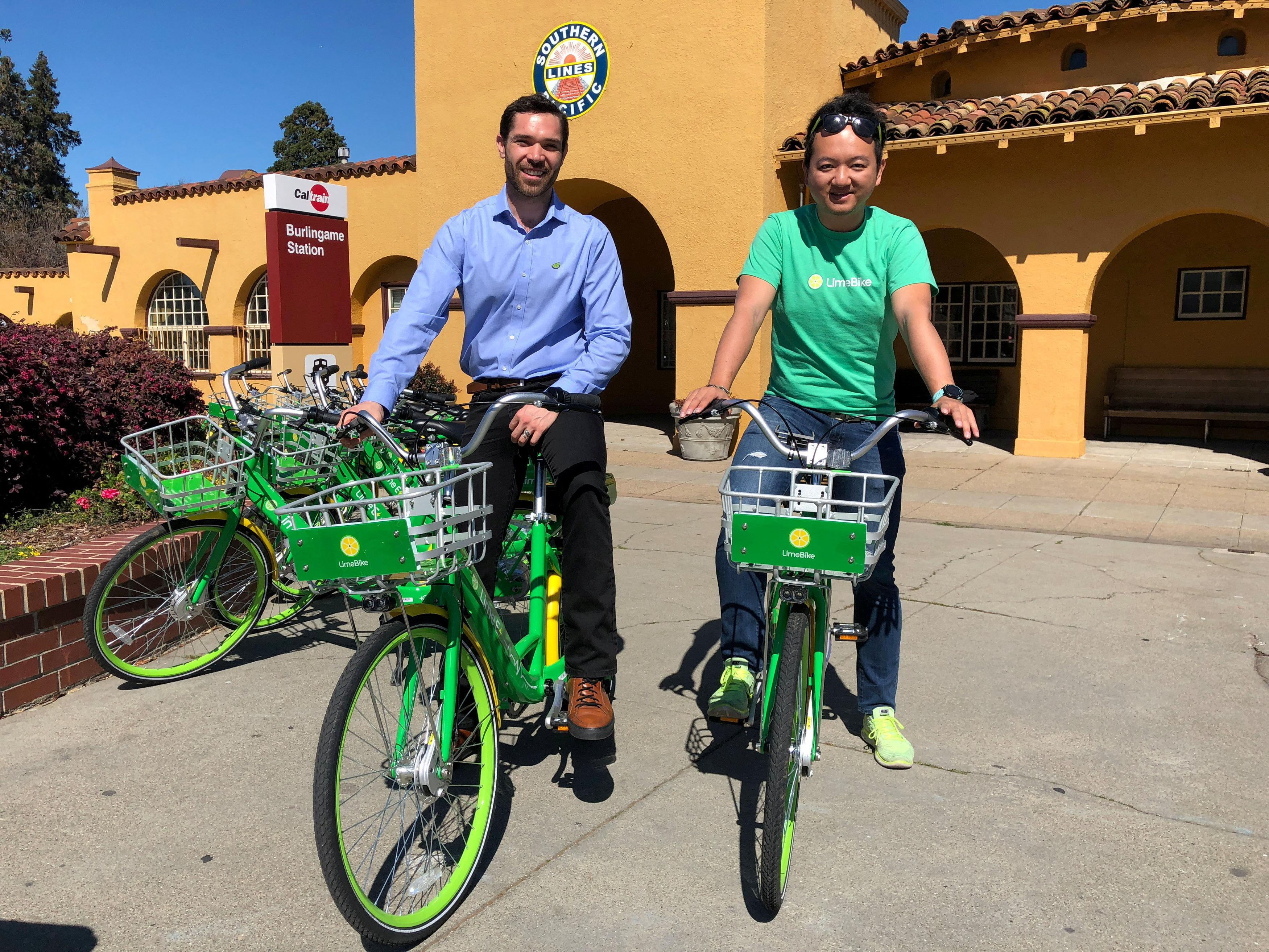 Co-founders Toby Sun (R) and Caen Contee of California-based bike sharing startup LimeBike show off their bikes at a recently-launched pilot program in Burlingame, California, U.S. March 8, 2017. Jane Lanhee Lee