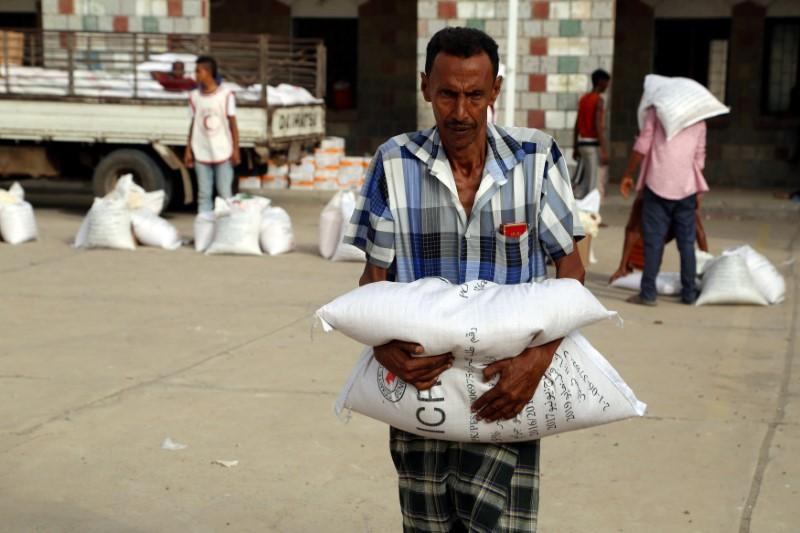 A displaced man receives aid kits distributed by (ICRC) International Committee of the Red Cross in the war-torn Red Sea port city of Hodeidah, Yemen June 21, 2018. Abduljabbar Zeyad