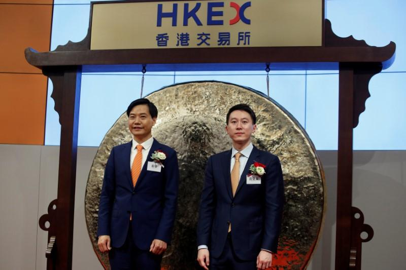 Xiaomi founder, Chairman and CEO Lei Jun (L) and CFO Shou Zi Chew attend the listing of the company at the Hong Kong Exchanges in Hong Kong, China July 9, 2018.   Bobby Yip