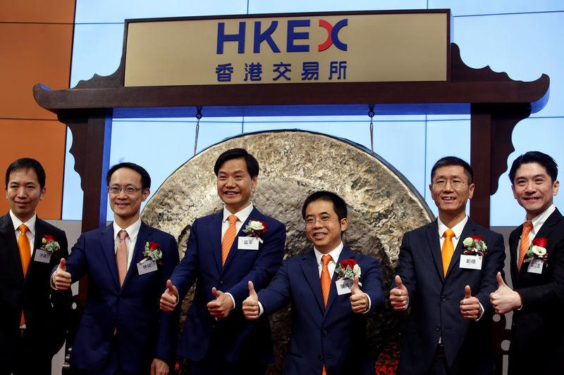 Xiaomi founder, Chairman and CEO Lei Jun (3rd L) attends the listing of the company at the Hong Kong Exchanges in Hong Kong, China July 9, 2018.   Bobby Yip