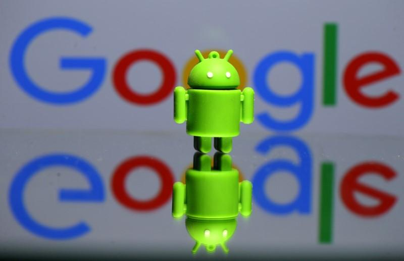 A 3D printed Android mascot Bugdroid is seen in front of a Google logo in this illustration taken July 9, 2017. Picture taken July 9, 2017.  Dado Ruvic/Illustration/r