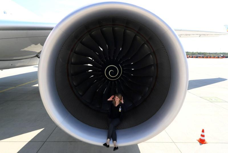PR agent Elsa Goette sits in a Rolls-Royce engine of an Airbus A350-900 of Ethiopian Airlines during a site-inspection at Fraport airport in Frankfurt, Germany, May 22, 2017.  Kai Pfaffenbach