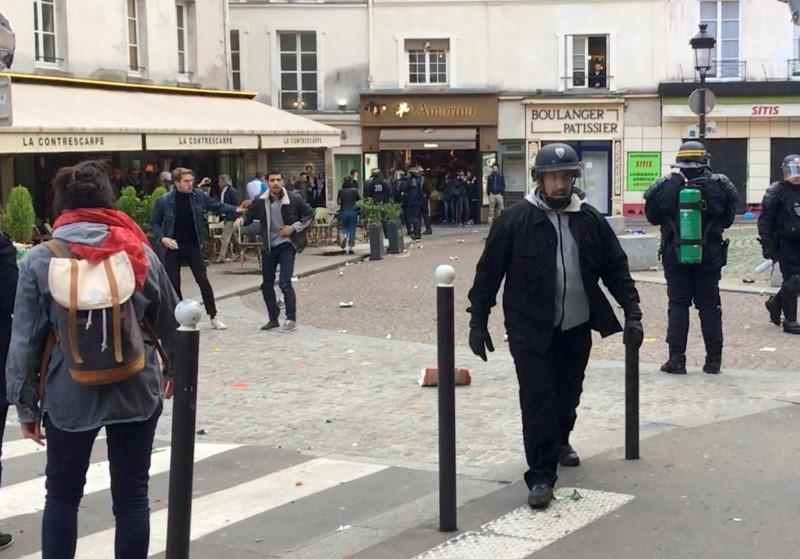Macron's bodyguard walks after clashing with a May Day protester in Paris, France, May 1, 2018 in this picture grab obtained from social media video. Courtesy of SONIA/via