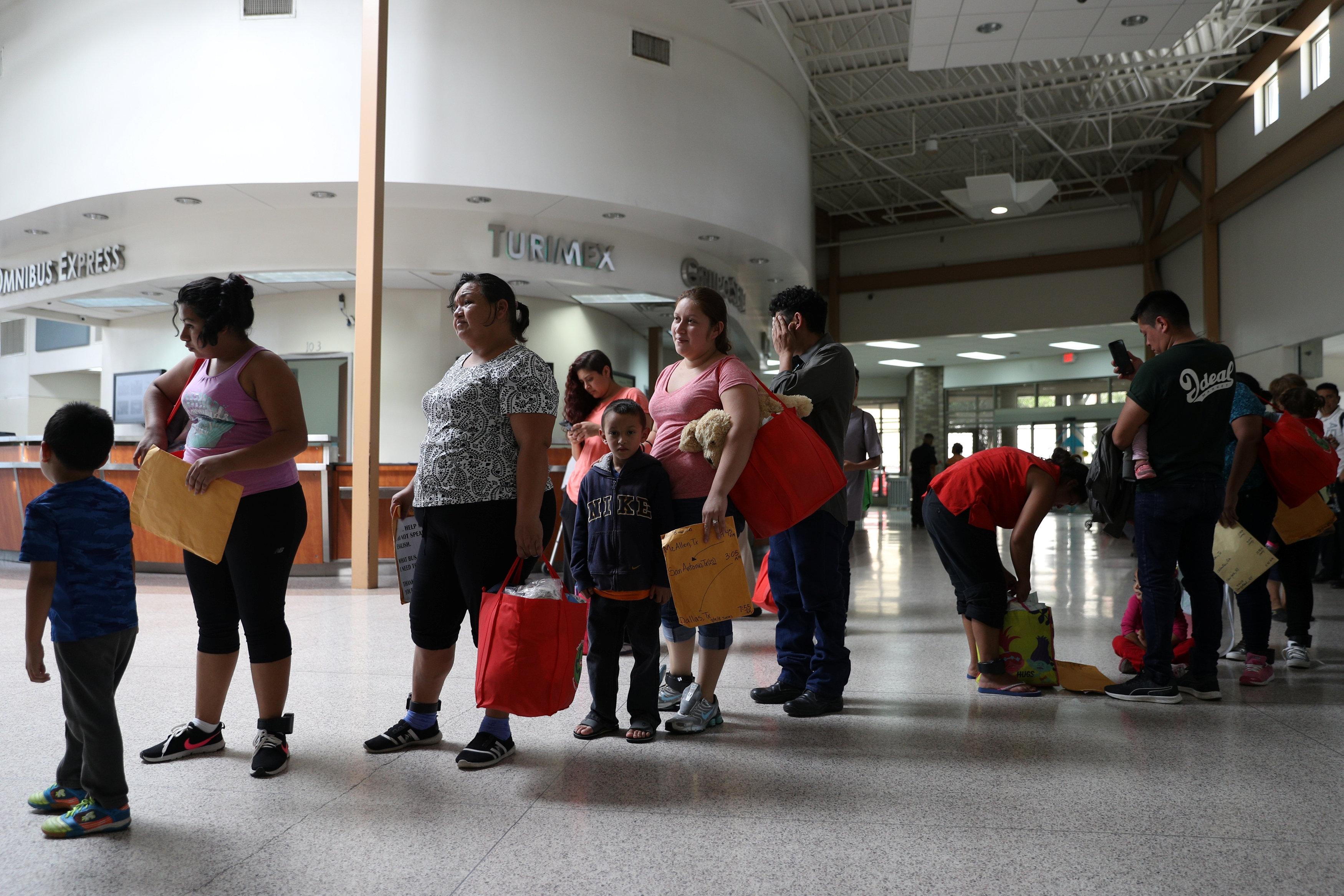 Undocumented immigrants recently released from detention prepare to depart a bus depot for cities around the country in McAllen, Texas, U.S., July 18, 2018. Picture taken July 18, 2018.  Loren Elliott