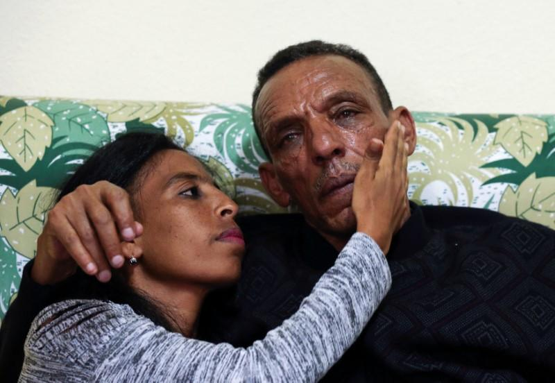 Addisalem Hadgu, 58, an Ethiopian state TV journalist, embraces his daughter Danayt Addisalem, after meeting for the first time in eighteen years, in Asmara, Eritrea July 19, 2018. Tiksa Negeri