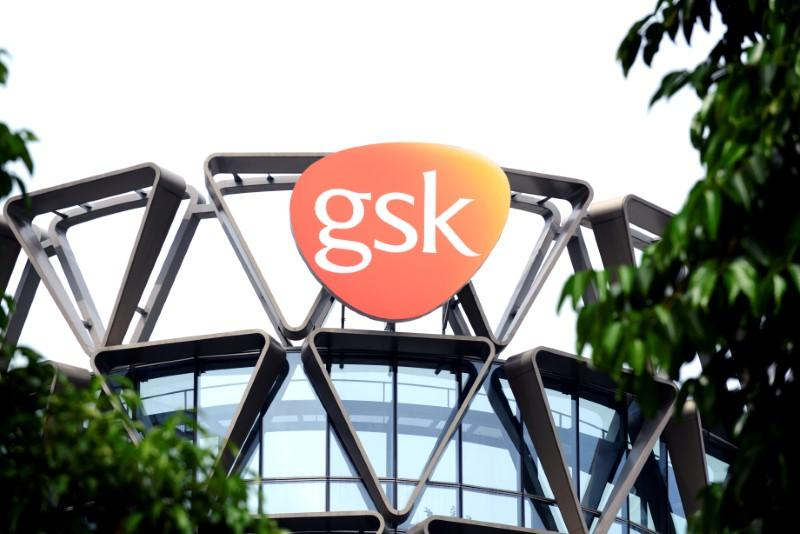 The GlaxoSmithKline (GSK) logo is seen on top of GSK Asia House in Singapore, March 21, 2018. Loriene Perera