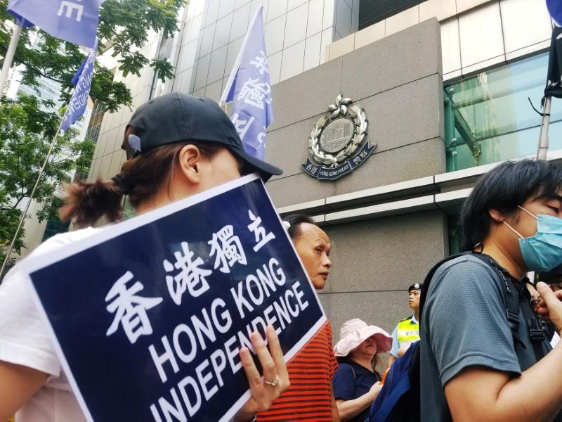 Pro-independence protesters supporting freedom of expression take part in a demonstration outside the Police Headquarters in Hong Kong, China July 21, 2018.   Venus Wu