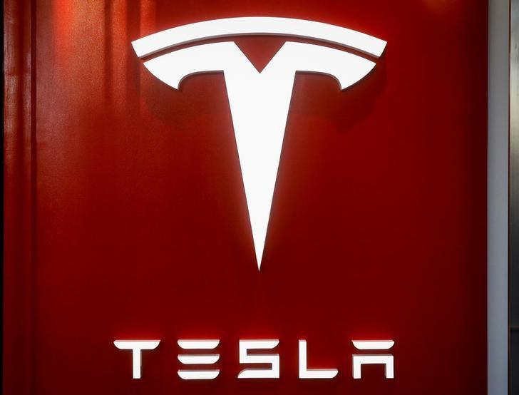 The Tesla logo is seen at the entrance to Tesla Motors' new showroom in Manhattan's Meatpacking District in New York City, U.S., December 14, 2017. Brendan McDermid