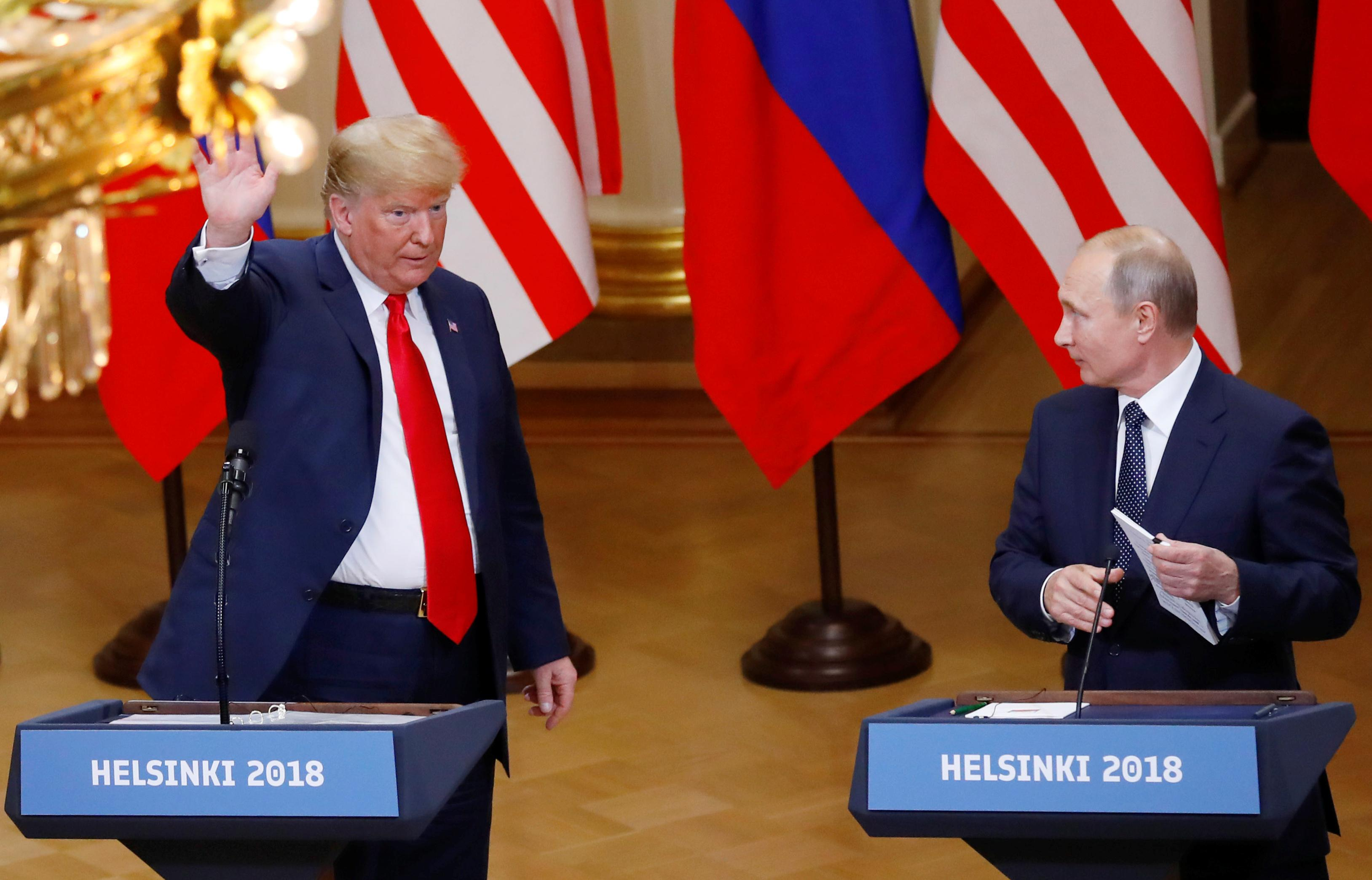 U.S. President Donald Trump and Russian President Vladimir Putin react at the end of the joint news conference after their meeting in Helsinki, Finland, July 16, 2018. Leonhard Foeger