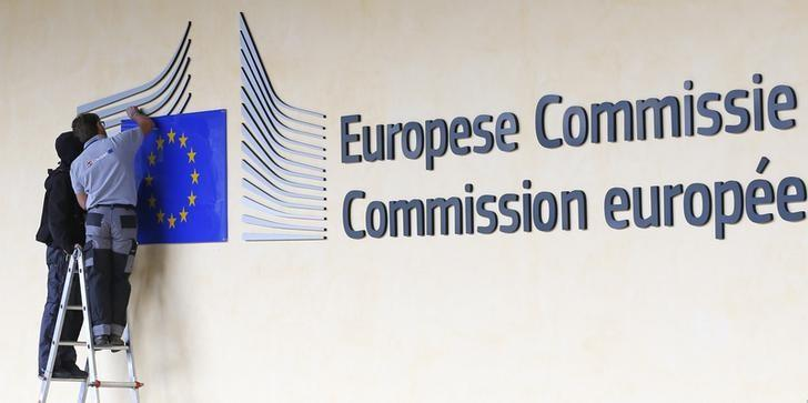 adjust and clean the logo of the European Commission at the entrance of the Berlaymont building, the EC headquarters, in Brussels September 12, 2013.   Yves Herman