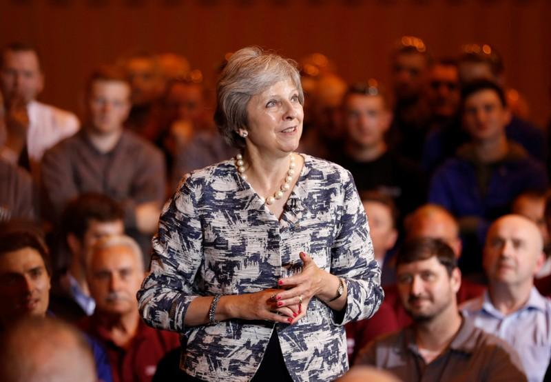 Britain's Prime Minister Theresa May answers questions during a Q&A session with employees at the Armstrong Works engineering facility, which is part of the Recce Group, in Newcastle upon Tyne, Britain, July 23, 2018. Russell Cheyne
