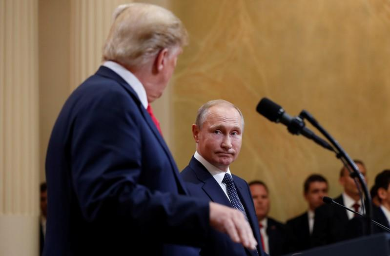 U.S. President Donald Trump and Russia's President Vladimir Putin hold a joint news conference after their meeting in Helsinki, Finland, July 16, 2018. Kevin Lamarque