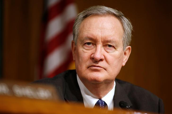 "Chairman of the Senate Banking, Housing, and Urban Affairs Committee Mike Crapo (R-ID) hearing listens to testimony from Federal Reserve Chairman Janet Yellen on the ""Semiannual Monetary Policy Report to the Congress"" on Capitol Hill in Washington, U.S., February 14, 2017.      Joshua Roberts"