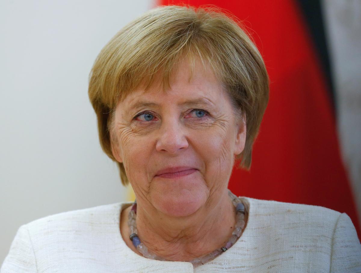 Merkel: Coalition won't fall apart due to dispute over top spy