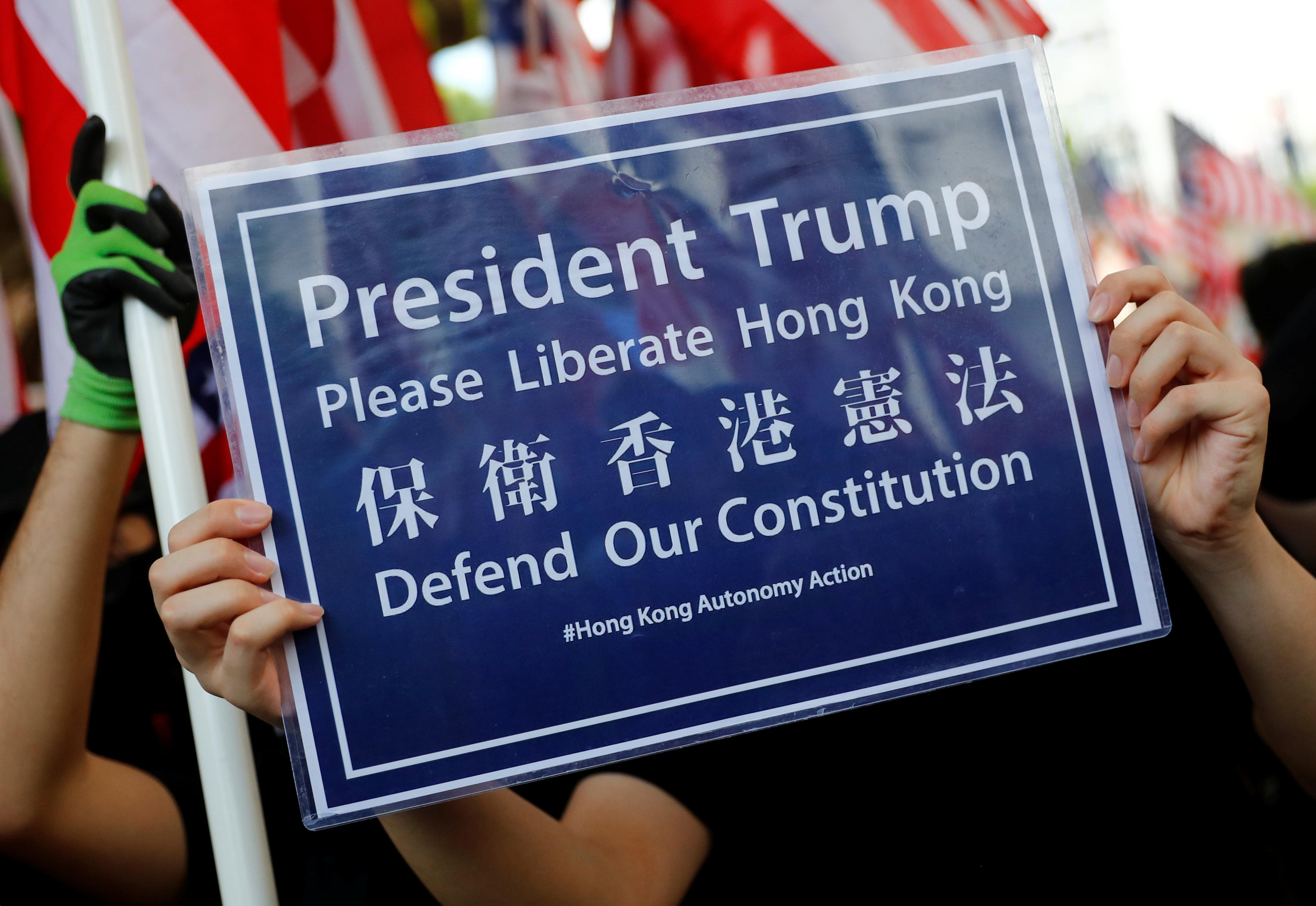 Hong Kong protesters, waving Stars and Stripes, call on Trump to 'liberate' city