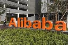 A security guard walks past a logo of Alibaba (China) Technology Co. Ltd at its headquarters on the outskirts of Hangzhou, Zhejiang province March 16, 2010. Alibaba.com, China's largest e-commerce company, posted a 49 percent rise in quarterly net profit as revenue growth accelerated on the back of strong customer additions.    REUTERS/Lang Lang (CHINA - Tags: BUSINESS SCI TECH) - RTR2BOYX