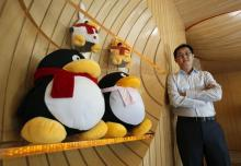 Tencent Chairman and CEO Pony Ma poses with mascots for QQ.com inside the company's headquarters in Nanshan Hi-Tech Industrial Park in the southern Chinese city of Shenzhen during an interview by Reuters June 9, 2011. Picture taken June 9, 2011.   REUTERS/Bobby Yip   (CHINA - Tags: BUSINESS SCI TECH) - RTR2NOGZ