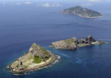 A group of disputed islands, Uotsuri island (top), Minamikojima (bottom) and Kitakojima, known as Senkaku in Japan and Diaoyu in China is seen in the East China Sea, in this photo taken by Kyodo September 2012. Japan and ally the United States sharply criticized China's move to impose new rules on airspace over islands at the heart of a territorial dispute with Tokyo, warning of an escalation into the
