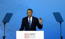 U.S. President Barack Obama speaks at the APEC CEO Summit at the China National Convention Centre (CNCC) in Beijing November 10, 2014, part of the Asia-Pacific Economic Cooperation (APEC) Summit. REUTERS/Wang Zhao/Pool (CHINA - Tags: POLITICS BUSINESS) - RTR4DK3H