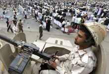 A defected army soldier sits on an armoured vehicle near anti-government protesters as they secure a street during a rally to demand the prosecution of former Yemeni President Ali Abdullah Saleh in Sanaa March 23, 2012. REUTERS/Mohamed al-Sayaghi