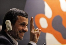 Iran's President Mahmoud Ahmadinejad flashes the peace sign during the high-level meeting of the General Assembly on the Rule of Law at the United Nations headquarters in New York September 24, 2012. REUTERS/Eduardo Munoz