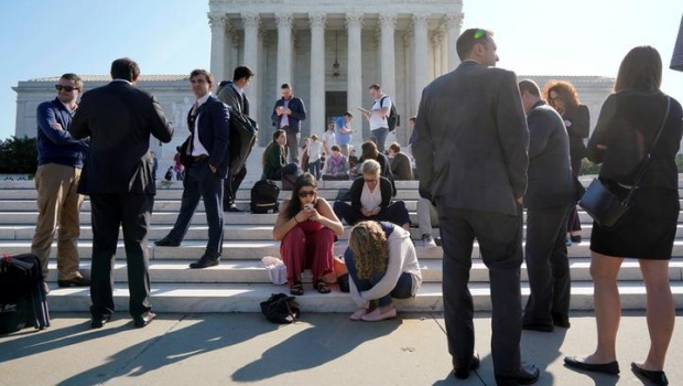People wait in line to attend the opening day of the new term of the Supreme Court in Washington, U.S., October 1, 2018. REUTERS/Aaron P. Bernstein