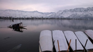 A man rows his boat in the waters of the Dal lake on a cold winter morning in Srinagar February 8, 2019. REUTERS/Danish Ismail