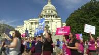 Demonstrators encircle U.S. Capitol in protest of healthcare bill