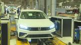 Volkswagen raises mid-term profit, sales outlook