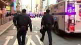 Explosion rocks New York commuter hub, suspect in custody